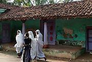 Women walking doen a street in Nagore.