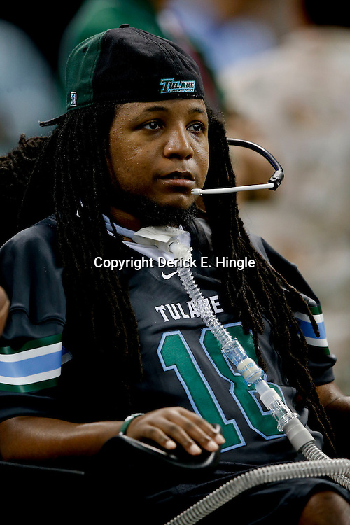 Aug 29, 2013; New Orleans, LA, USA; Former Tulane Green Wave player Devon Walker on the sideline during the first half of a game against the Jackson State Tigers at the Mercedes-Benz Superdome. Mandatory Credit: Derick E. Hingle-USA TODAY Sports