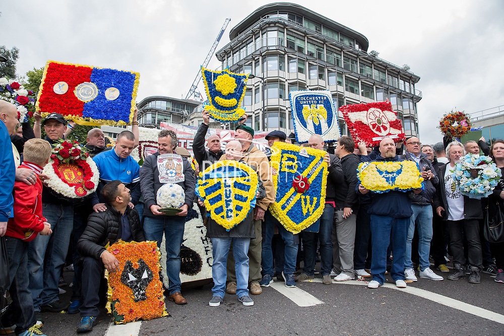 Football Club wreaths during the Football Lads Alliance march between Park Lane and Westminster Bridge, London on 7 October 2017. Photo by Phil Duncan.