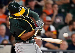 Oakland Athletics' Marcus Semien hits an RBI double in the sixth inning of a baseball game against the Houston Astros, Sunday, July 10, 2016, in Houston. (AP Photo/Eric Christian Smith)