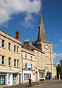 Market place buildings and St Andrew's church spire, Chippenham, Wiltshire, England, UK