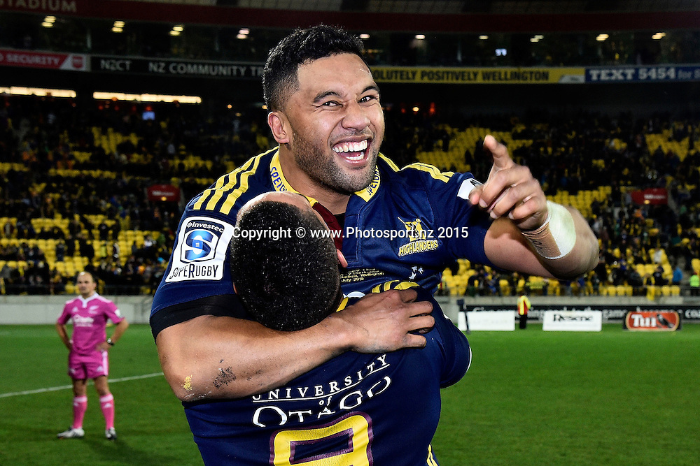 Lima Sopoaga (Top) with team mate Aaron Smith of the Highlanders celebrate their win during the Super Rugby final rugby match between the Hurricanes and Highlanders at the Westpac Stadium in Wellington on Saturday the 4th of July 2015. Copyright photo by Marty Melville / www.Photosport.nz