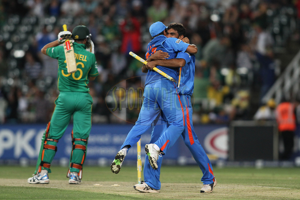 Suresh Raina of India celebrates with Munaf Patel of India after getting Wayne Parnell of South Africa out to beat South Africa by 1 run during the 2nd ODI between South Africa and India held at Wanderers Stadium in Johannesburg, South Africa on the 15th January 2011..Photo by Shaun Roy/BCCI/SPORTZPICS
