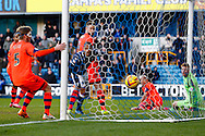Simeon Jackson of Millwall (centre) watches as Martyn Woolford of Millwall (not shown) scores to make it 1-1 during the Sky Bet Championship match at The Den, London<br /> Picture by David Horn/Focus Images Ltd +44 7545 970036<br /> 15/02/2014