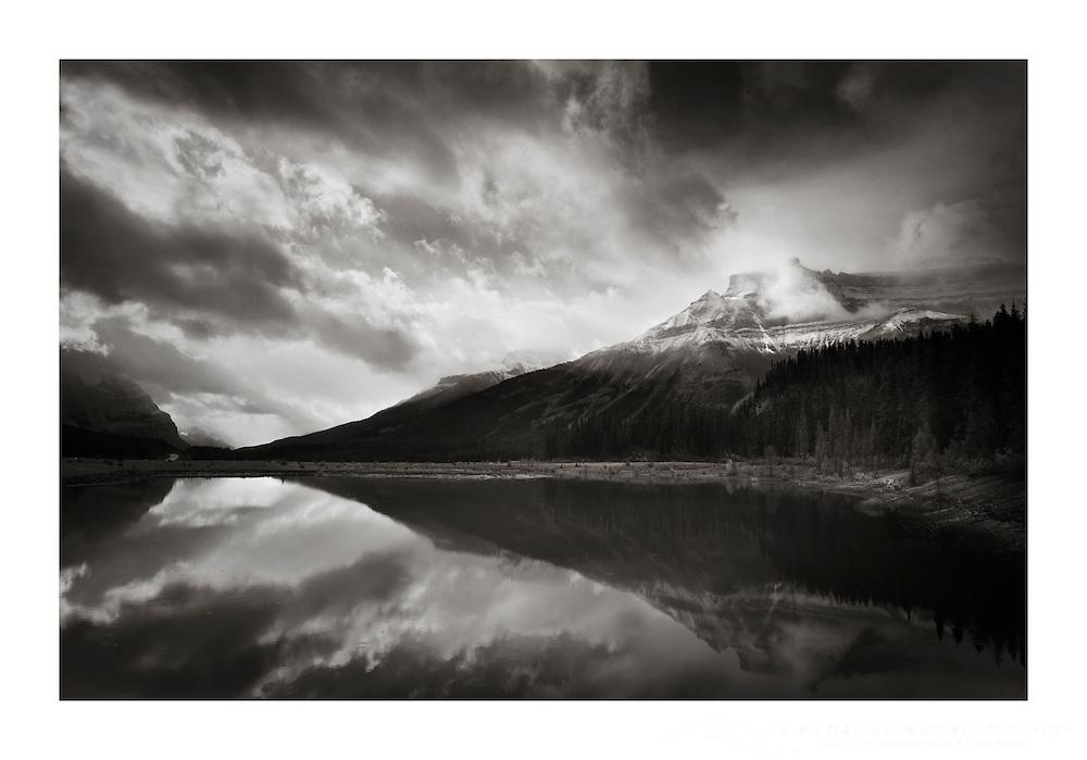 Mountain reflection in North Sasakatchewan River, Banff National Park Alberta