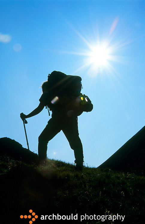 Hiker, siloette, Kluane, Yukon.<br /> <br /> NOT IN YOUR BUDGET? Contact Cathie for a price specific to your project.