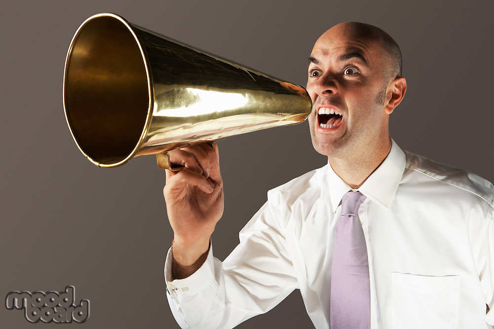 Balding Middle-aged businessman shouting through megaphone