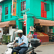 Policeman on scooter in Little India, Singapore