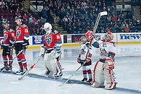 KELOWNA, CANADA - NOVEMBER 5:  Devante Stephens #21, Braydyn Chizen #22 and Michael Herringer #30 of the Kelowna Rockets line up with the Pepsi Save ON Foods players of the game against the Medicine Hat Tigers on November 5, 2016 at Prospera Place in Kelowna, British Columbia, Canada.  (Photo by Marissa Baecker/Shoot the Breeze)  *** Local Caption ***