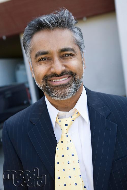 Man wearing suit, outdoors, portrait