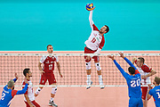 Poland, Warsaw - 2017 August 24: (C) Michal Kubiak from Poland spikes during LOTTO EUROVOLLEY POLAND 2017 - European Championships in volleyball at Stadion PGE Narodowy on August 24, 2017 in Warsaw, Poland.<br /> <br /> Mandatory credit:<br /> Photo by &copy; Adam Nurkiewicz<br /> <br /> Adam Nurkiewicz declares that he has no rights to the image of people at the photographs of his authorship.<br /> <br /> Picture also available in RAW (NEF) or TIFF format on special request.<br /> <br /> Any editorial, commercial or promotional use requires written permission from the author of image.