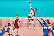 Poland, Warsaw - 2017 August 24: (C) Michal Kubiak from Poland spikes during LOTTO EUROVOLLEY POLAND 2017 - European Championships in volleyball at Stadion PGE Narodowy on August 24, 2017 in Warsaw, Poland.<br /> <br /> Mandatory credit:<br /> Photo by © Adam Nurkiewicz<br /> <br /> Adam Nurkiewicz declares that he has no rights to the image of people at the photographs of his authorship.<br /> <br /> Picture also available in RAW (NEF) or TIFF format on special request.<br /> <br /> Any editorial, commercial or promotional use requires written permission from the author of image.