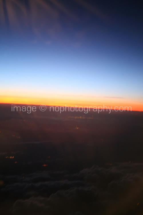Blurry Sunset view out of airplane window