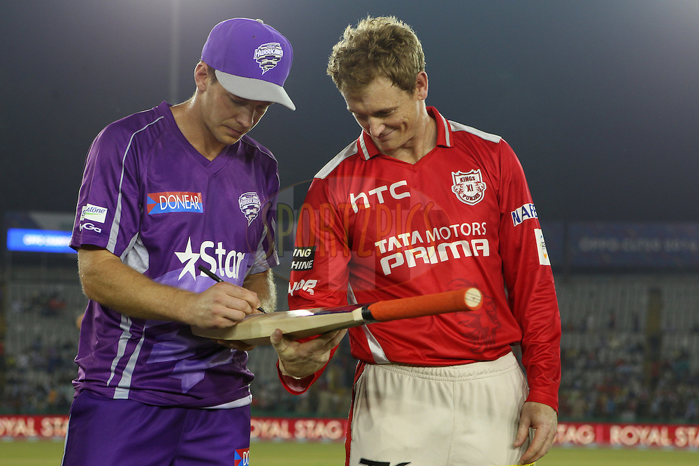 Tim PAINE (Captain) of the Hobart Hurricanes  and George BAILEY (Captain) of the Kings XI Punjab sign the MCC bat at the toss during match 2 of the Oppo Champions League Twenty20 between the Kings XI Punjab and the Hobart Hurricanes held at the Punjab Cricket Association Stadium, Mohali, India on the 18th September 2014<br /> <br /> Photo by:  Ron Gaunt / Sportzpics/ CLT20<br /> <br /> <br /> Image use is subject to the terms and conditions as laid out by the BCCI/ CLT20.  The terms and conditions can be downloaded here:<br /> <br /> http://sportzpics.photoshelter.com/gallery/CLT20-Image-Terms-and-Conditions-2014/G0000IfNJn535VPU/C0000QhhKadWcjYs