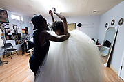 Designer Jacqueline Addison, left, owner of Akua Gabby, works with model Lydia Negussie during a fitting at Addison's studio in Northeast Minneapolis. Negussie said she enjoys getting to be a part of other people's creative process. She also appreciates the community-building aspect of Black Fashion Week and its support of black artists.
