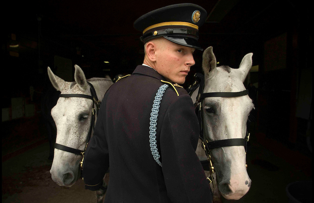 A member of the U.S. Army's  Old Guard prepares for another funeral at Arlington National Cemetery.   Photo by Johnny Bivera