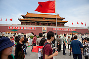 "Visitors and tourists at the main gate of ""The Forbidden City"" which was the Chinese imperial palace from the Ming Dynasty to the end of the Qing Dynasty. It is located in the middle of Beijing, China. Beijing is the capital of the People's Republic of China and one of the most populous cities in the world with a population of 19,612,368 as of 2010."