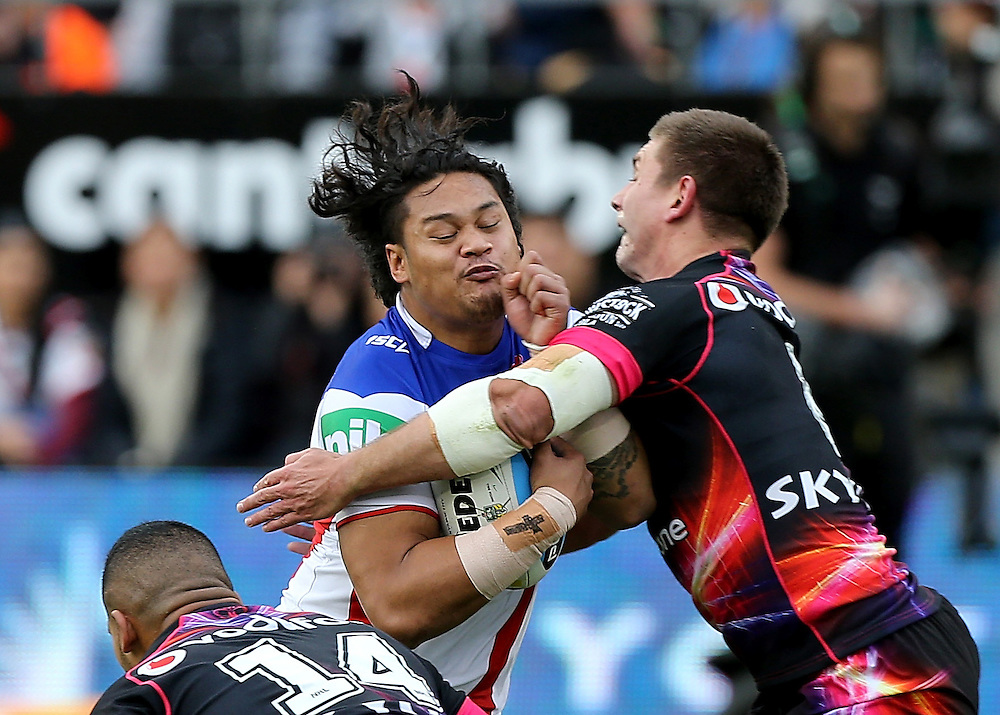Joseph Leilua  of the Newcastle Knights is tackled by Siliva Havili of the New Zealand Warriors and Jacob Lillyman during their round 12 NRL match at Mount Smart Stadium, Auckland on  Sunday, May 31, 2015. Credit: SNPA / David Rowland