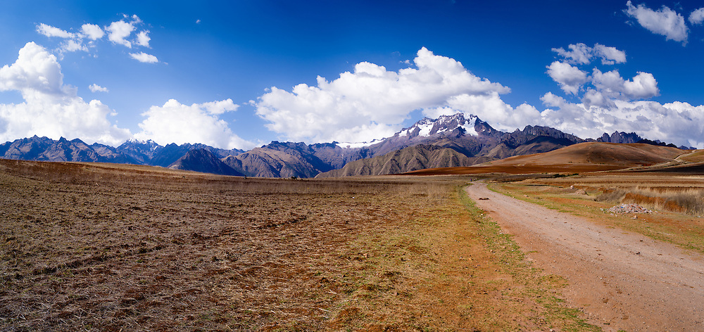 View of the Cordillera Urupampa mountain range in the Peruvian Andes, looming over the Sacred Valley, Peru; Chicon (18,143') is the highest mountain in the right center of this photo.