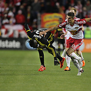 Kei Kamara, (left), Columbus Crew SC, beats the challenge of Matt Miazga, New York Red Bulls, during the New York Red Bulls Vs Columbus Crew SC, Major League Soccer Eastern Conference Championship, second leg, at Red Bull Arena, Harrison, New Jersey. USA. 29th November 2015. Photo Tim Clayton