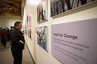 José Arreola, community safety administrator for the City of Salinas, takes in the photography at the December 5th, 2017 opening of the Stories from Salinas exhibition at the CSUMB Salinas Center for Arts and Culture in Oldtown. The exhibition celebrates the mentors, youth and families of the Salinas Youth Initiative.