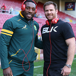 CAPE TOWN, SOUTH AFRICA - JUNE 07: Tendai Mtawarira of South Africa with Craig Burden of the World XV during the International match between South Africa and World XV from DHL Newlands Stadium on June 07, 2014 in Cape Town, South Africa. (Photo by Steve Haag)