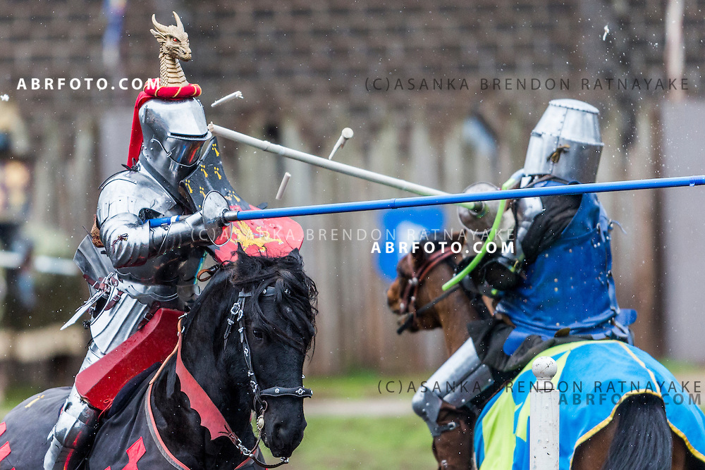Phillip Leitch (L) fends off an attack by David Williamson (R) during a professional jousting competition.