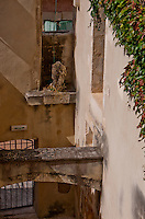 Inner courtyard scene in Chateaurenard, Provence, France showing traditional building and workmanship.