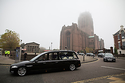 © Licensed to London News Pictures . 02/11/2015 . Liverpool , UK . The cortege leaves the Cathedral after the service . The funeral of Police Constable Dave Phillips , at Liverpool Cathedral . Five people are charged in connection with his death , including Clayton Williams , 18 , from Wallasey , who is charged with murder . Photo credit: Joel Goodman/LNP