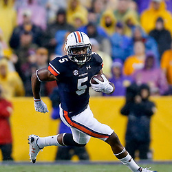Sep 21, 2013; Baton Rouge, LA, USA; Auburn Tigers wide receiver Ricardo Louis (5) against the LSU Tigers during the first half of a game at Tiger Stadium. Mandatory Credit: Derick E. Hingle-USA TODAY Sports