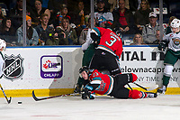 KELOWNA, BC - SEPTEMBER 28:  Sean Comrie #3 checks a player into the boards as Jake Poole #23 of the Kelowna Rockets reaches for the puck from the ice against the Everett Silvertips  at Prospera Place on September 28, 2019 in Kelowna, Canada. (Photo by Marissa Baecker/Shoot the Breeze)