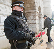 © Licensed to London News Pictures. 22/01/2015. London, UK Armed police officers in and around central London today 22 January 2015. UK Foreign Secretary Philip Hammond said that ISIS is the greatest threat to the UK's security at the moment. Photo credit : Stephen Simpson/LNP