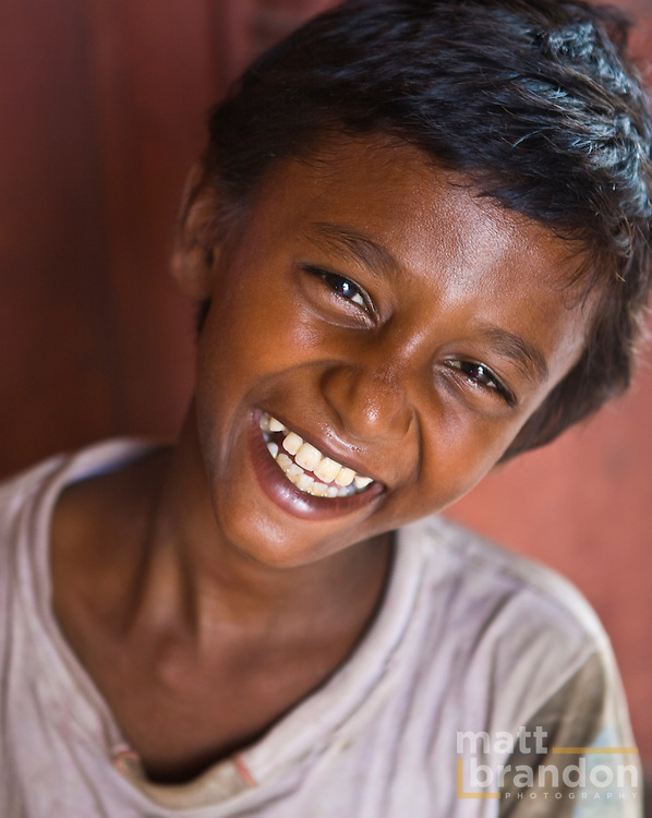 A portrait of a young boy  sitting in the Jama masjid, Old Delhi.