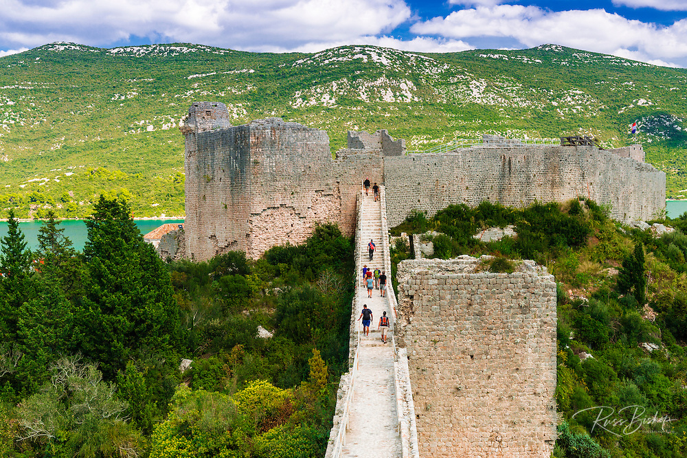 Tourists on the Great Wall above Mali Ston, Ston, Dalmatian Coast, Croatia