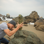 Urbanite Hugh Lau setting rocks at Mile Rock Beach at Land's End in San Francisco.