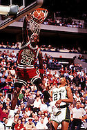 MILWAUKEE, WI-UNDATED:  NBA superstar and Hall of Fame player Michael Jordan makes a spectacular slam against the Milwaukee Bucks at The Mecca in Milwaukee, Wisconsin.  Jordan played for the Bulls from 1984-1993 and 1995-1998.  (Photo by Ron Vesely)