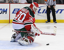 Mar 17, 2010; Newark, NJ, USA; New Jersey Devils goalie Martin Brodeur (30) makes a save during the third period at the Prudential Center. The Devils defeated the Penguins 5-2.