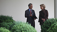 White House Chief of Staff Rahm Emanuel and Secretary of State Hillary Rodham Clinton talk while President Obama and President Lee of South Korea talk to media in the Rose Garden of the White House on June 16, 2009.  Photograph by Dennis Brack