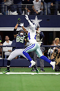 Seattle Seahawks wide receiver Doug Baldwin (89) tries to catch a late second quarter deep pass broken up by leaping Dallas Cowboys cornerback Chidobe Awuzie (24) during the NFL football NFC wild card playoff game against the Dallas Cowboys on Saturday, Jan. 5, 2019 in Arlington, Tex. The Cowboys won the game 24-22. (©Paul Anthony Spinelli)