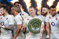 England Hooker Dylan Hartley (capt) holds the trophy after England hang on to win the match 25-21 to lift the Triple Crown having beaten Scotland, Ireland and Wales in the 6 Nations - Mandatory byline: Rogan Thomson/JMP - 12/03/2016 - RUGBY UNION - Twickenham Stadium - London, England - England v Wales - RBS 6 Nations 2016.