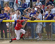 Nebraska third baseman Steve Edlefsen (9) battles the K-State fans for a foul ball down the left field line.  Nebraska held on to be Kansas State 5-4 at Tointon Stadium in Manhattan, Kansas, April 1, 2006.