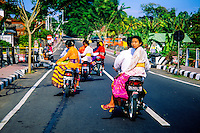 Couples riding on motorcycles, Amlapura, Bali, Indonesia