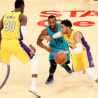 28 February 2017: Los Angeles Lakers guard D'Angelo Russell (1) drives past Charlotte Hornets guard Kemba Walker (15) on a screen set by Los Angeles Lakers forward Julius Randle (30) during the Charlotte Hornets 109-104 victory over the LA Lakers, at the Staples Center, Los Angeles, California, USA.