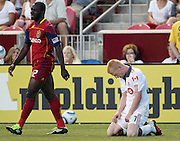Toronto FC defender Richard Eckersley, right, reacts after a failed attempt to score as Real Salt Lake midfielder Jean Alexandre, left walks past during the second half of an MLS soccer game, Saturday, June 25, 2011, in Sandy, Utah. Real Salt Lake defeated Toronto FC 3-1. (AP Photo/Colin Braley)