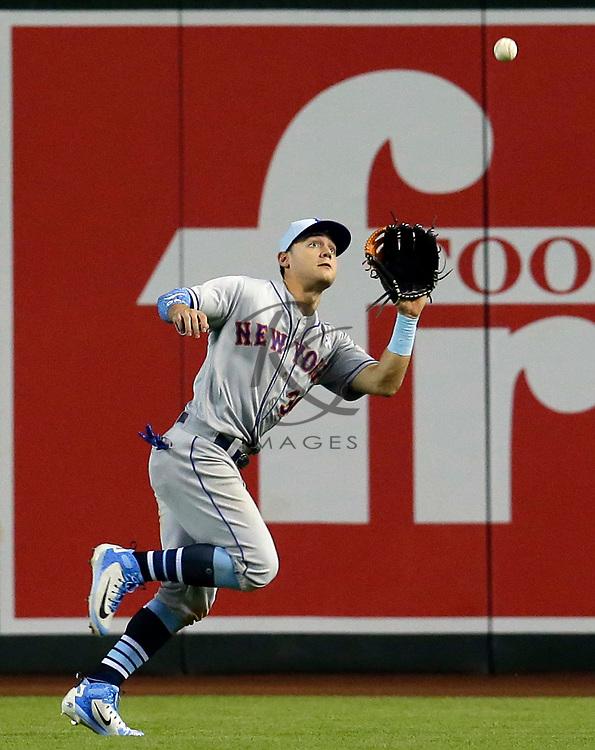 New York Mets left fielder Michael Conforto (30) in the first inning during a baseball game against the Arizona Diamondbacks, Sunday, June 17, 2018, in Phoenix. (AP Photo/Rick Scuteri)