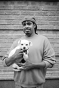 An afro american man with his dog, South Bronx. New York City, 17 june 2010. Christian Mantuano / OneShot