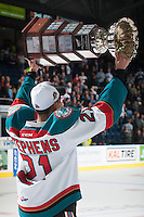 KELOWNA, CANADA - MAY 13: Devante Stephens #21 of Kelowna Rockets skates with the WHL Championship trophy on May 13, 2015 during game 4 of the WHL final series at Prospera Place in Kelowna, British Columbia, Canada.  (Photo by Marissa Baecker/Shoot the Breeze)  *** Local Caption *** Devante Stephens