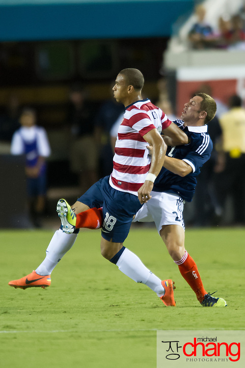 May 26 2012: USA's Terrence Boyd (18) takes a shot to the groin by Scotland's Phil Bardsley (2) during the second half of play of the U.S. Men's National Soccer Team game against Scotland at Everbank Field in Jacksonville, FL. USA defeated Scotland 5-1.