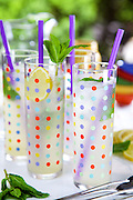 A playful setup of mint lemonade on a hot summer day. Glasses courtesy of Fishs Eddy in New York City