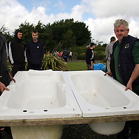 Bernard Cooney and Frank Finucane put a tub into the water before the race at the Kilmihil Festival of Fun at the weekend.<br /> Photograph by Yvonne Vaughan